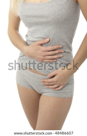 Woman stroking her belly; bellyache or constipation - stock photo