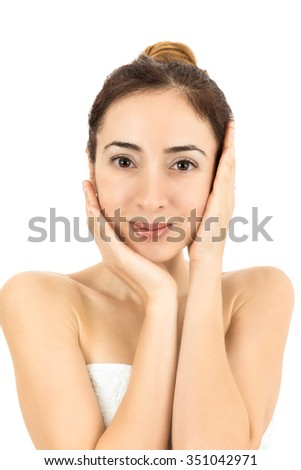 Woman stroking her clean facial skin