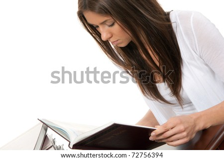 Woman student reading and studying book in college isolated on a white background - stock photo