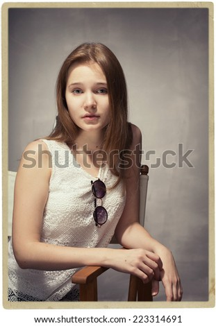 woman studio hipster portrait with sun glasses