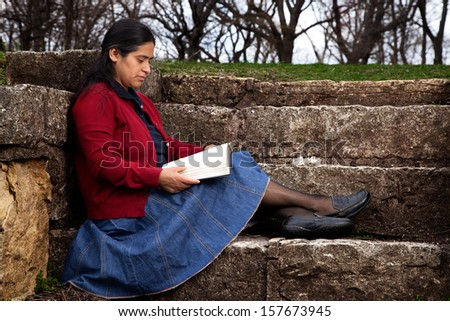 Woman Studying the Bible Outdoors