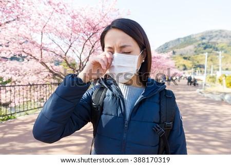 Woman suffer from allergy from pollen allergy at sakura season - stock photo