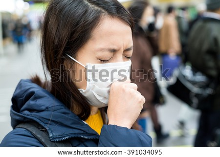 Woman suffer from sick in crowded of people - stock photo