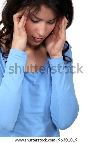 Woman suffering from a headache - stock photo