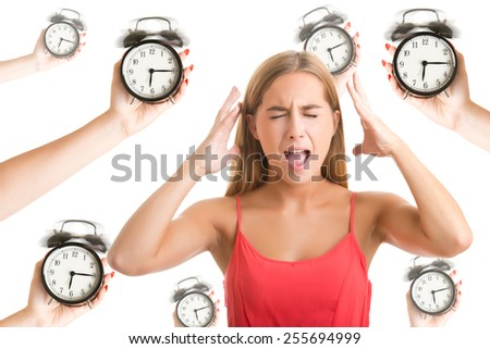Woman suffering from a nervous breakdown, holding her hands to her head, with alarm clocks around her, isolated in white - stock photo