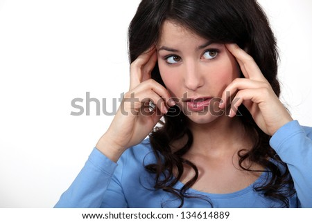 Woman suffering from a throbbing headache - stock photo