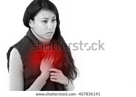 woman suffering from acid reflux or heartburn - stock photo