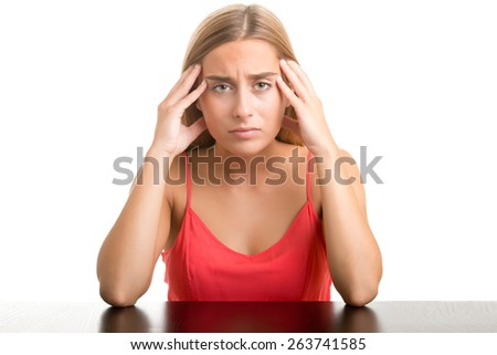 Woman suffering from an headache, holding her hand to the head, isolated in white