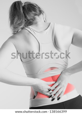 woman suffering from back pains