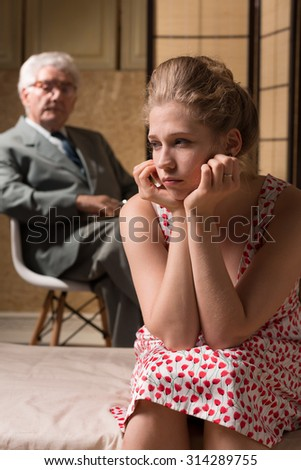 Woman suffering from depression during psychological therapy - stock photo