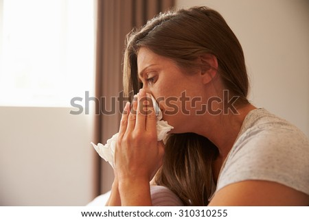 Woman Suffering From Depression Sitting On Bed And Crying - stock photo