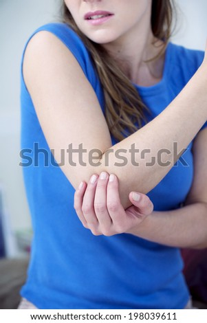 Woman suffering from elbow pain. - stock photo