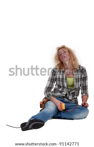 Woman suffering from electric shock - stock photo