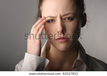 Woman suffering from headache - stock photo