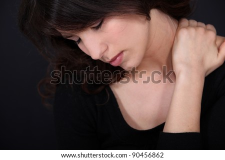 Woman suffering from neck pain - stock photo