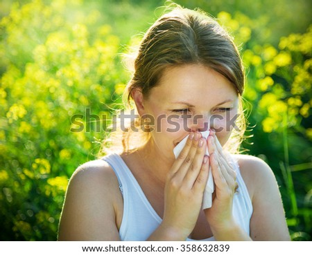 woman suffering from pollen allergy - stock photo