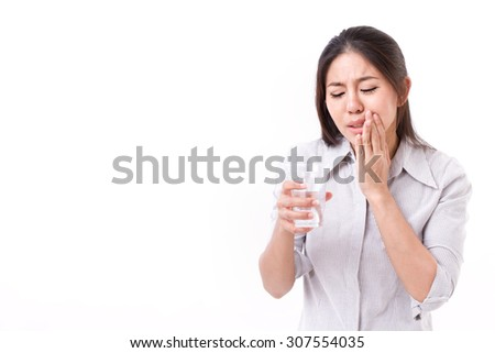 woman suffering from tooth sensitivity - stock photo