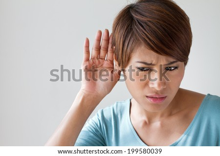 woman suffers from hearing impairment, hard of hearing, hearing loss, acoustic or ear problem, deafness with text space - stock photo