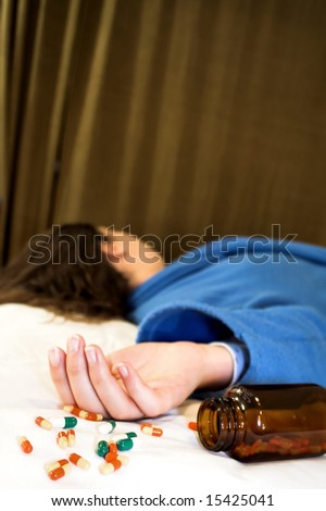woman suicide with pills - stock photo