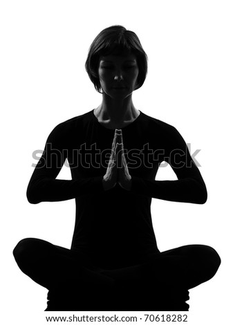 woman sukhasana pose meditation yoga posture position in silouhette on studio white background - stock photo