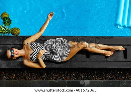 Woman Summer Fashion. Happy Sexy Smiling Girl With Fit Body, Long Legs, Healthy Skin In Bikini, Sun Hat, Sunglasses Sunbathing By Swimming Pool On Travel Holidays Vacation. Beauty, Wellness, Lifestyle - stock photo