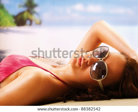 woman sunbathing in beach - stock photo