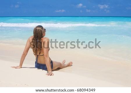 Woman Sunbathing on a Beach Vacation - stock photo