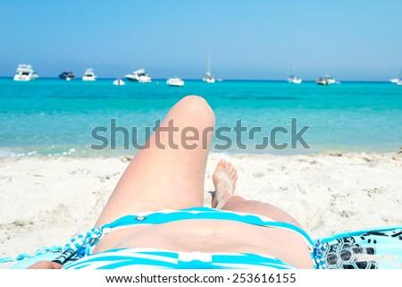 Woman sunbathing on the wonderful white beach of Saleccia Corsica France - stock photo