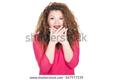 Woman surprised, amazed, being chosen over white background.