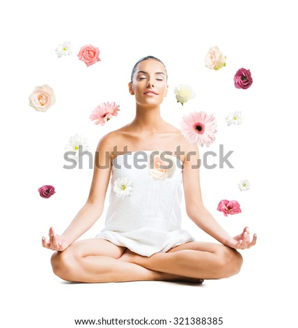 Woman surrounded by beautiful flowers isolated on white  - stock photo