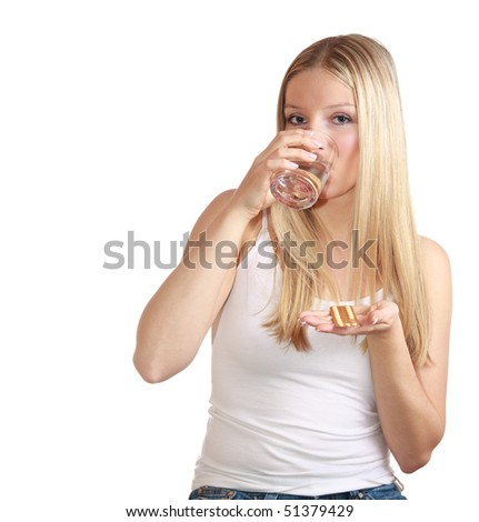 Woman swallowing birth control pills - stock photo
