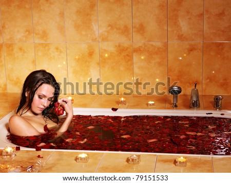 Woman swimming of bath tub. - stock photo