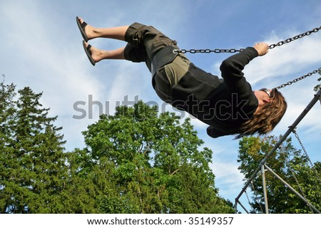 Woman swinging on playground swing set