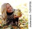 woman take autumn gift in park - stock photo