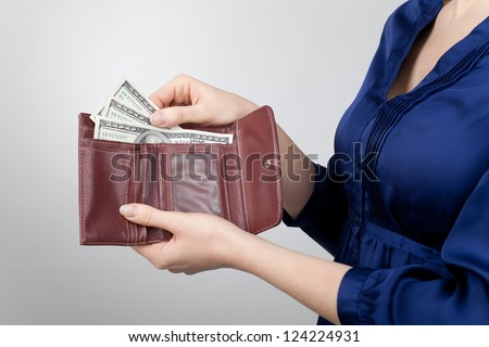 Woman take dollar money out from wallet. - stock photo