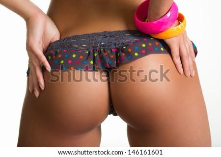 Woman take off her panties - stock photo