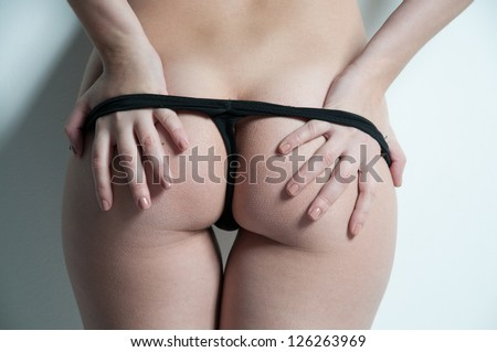 woman take off her penties - stock photo