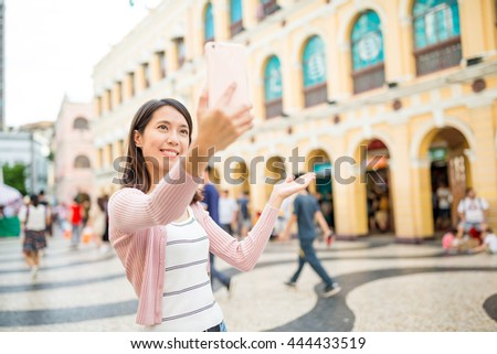 Woman take selfie in Macao city