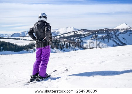 woman takes a rest while skiing - stock photo