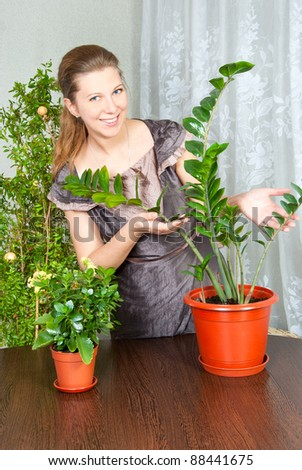 woman takes care of the flowers - stock photo