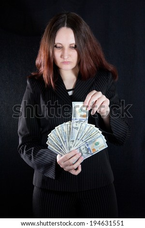 Woman takes money