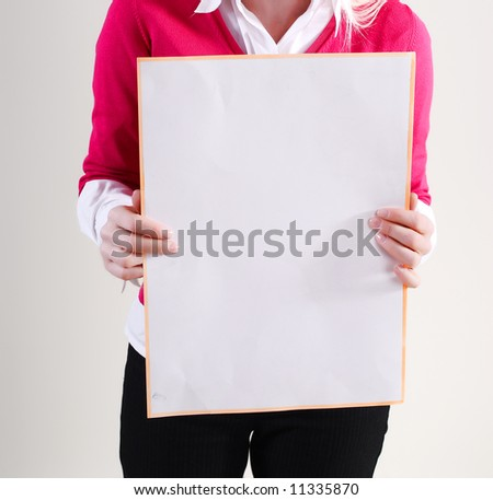 Woman takes placard at white background