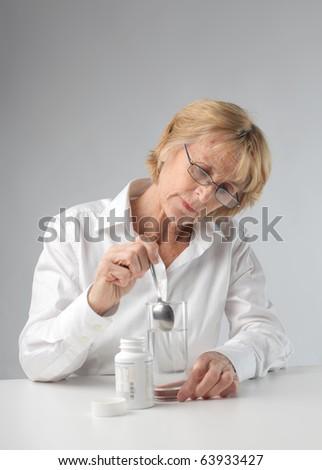 Woman taking a medicinal - stock photo