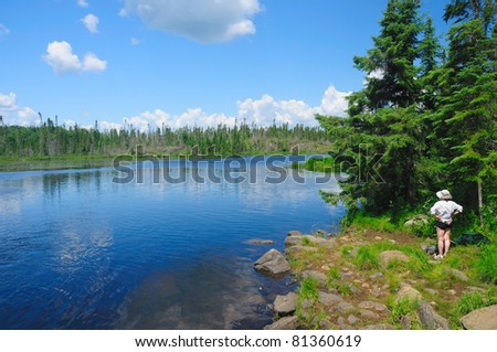 Woman taking a moment to enjoy the wilderness - stock photo