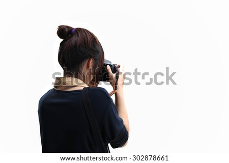 Woman taking a photo with dslr camera in white background