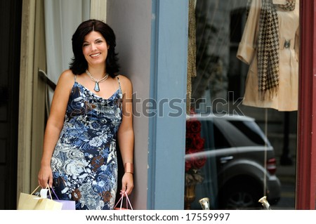 Woman Taking A Rest During A Clothes Shopping Trip - stock photo