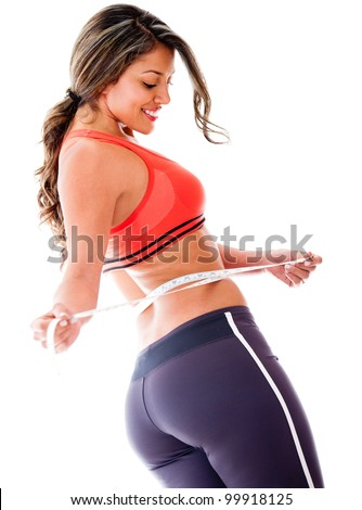 Woman taking body measurements - isolated over a white background - stock photo