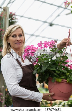 woman taking care of flowers