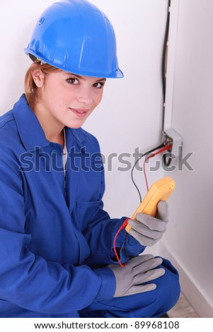 Woman taking electrical reading - stock photo