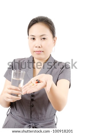 Woman taking her medicine isolated, selective focus on lady face.